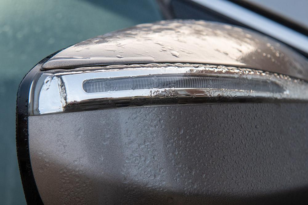 morning moisture accumulates on car mirror.jpg