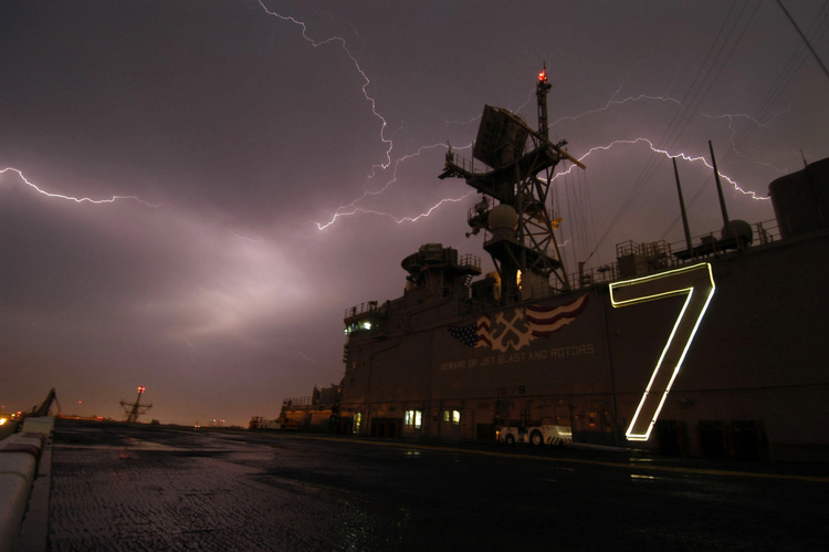 lightning-behind-amphibious-assault-ship-uss-iwo-jima001-photo.jpg