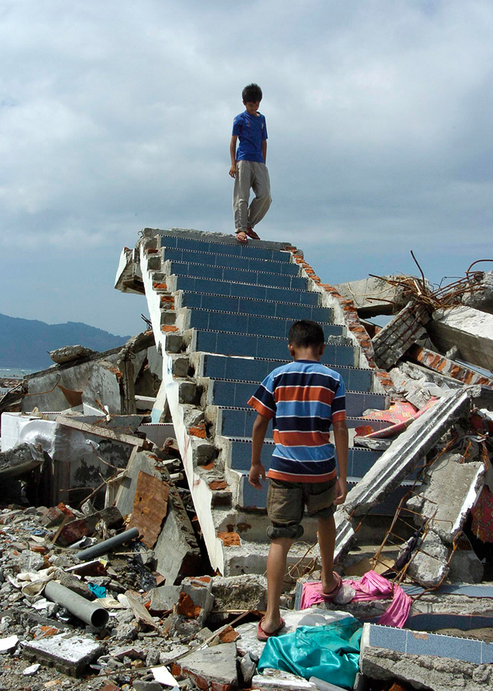 children-on-the-remains-of-their-home-after-tsunami.jpg
