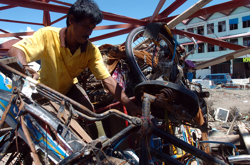 indonesian-man-sifts-through-the-rubble.jpg