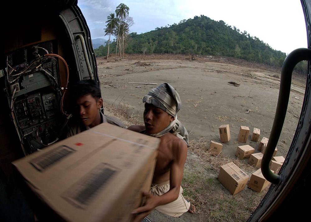 local-children-help-unload-humanitarian-relief-supplies.jpg