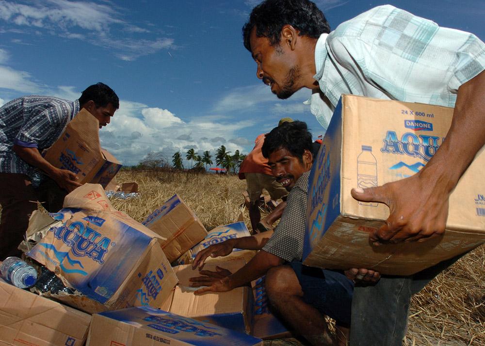 tsunami-victims-anxiously-grab-relief-supplies.jpg