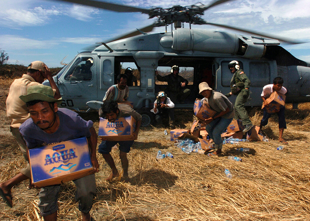 tsunami-victims-grab-relief-supplies-from-helicopter.jpg