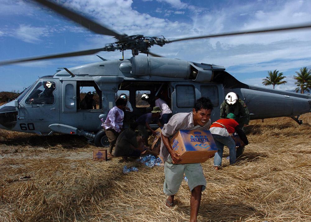 tsunami-victims-grab-relief-supplies.jpg
