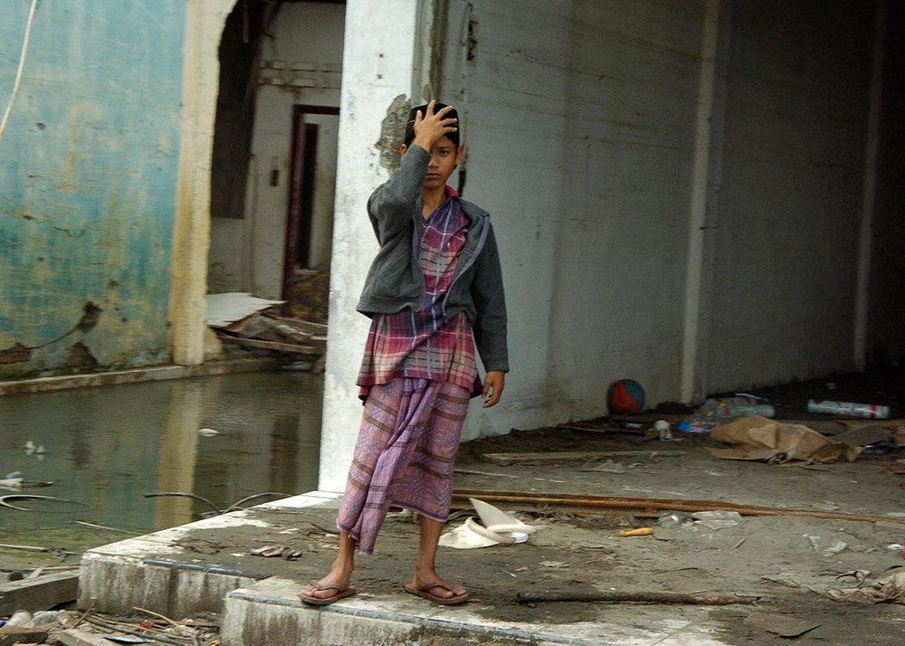 young-indonesian-boy-appears-overwhelmed-by-the-devastation.jpg