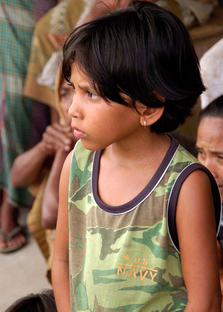 young-indonesian-child-listens-about-relief-aid.jpg