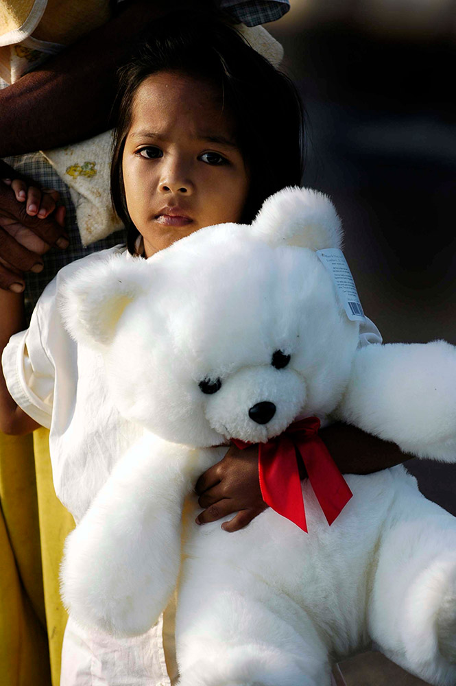 young-indonesian-girl-clasps-her-new-teddy-bear.jpg