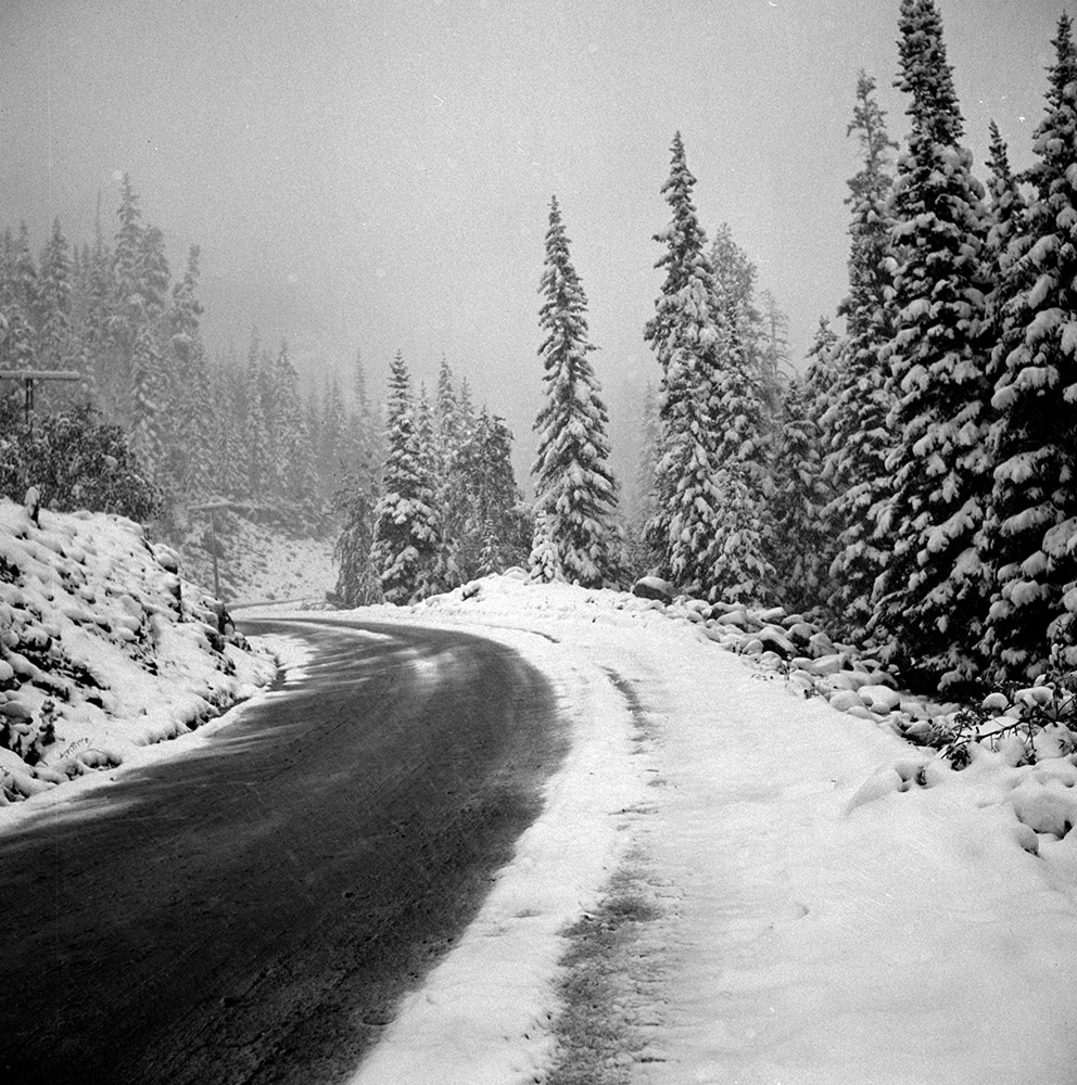 highway-in-snow-covered-mountains-during-early-fall-blizzard-colorado-1947.jpg