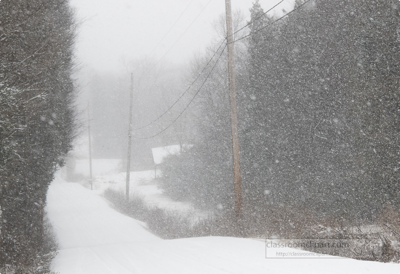 photo-of-snow-falling-along-a-country-road-tennessee-1300.jpg