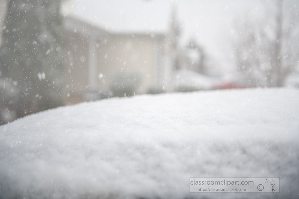 snow-accumulating-on-hood-of-car.jpg