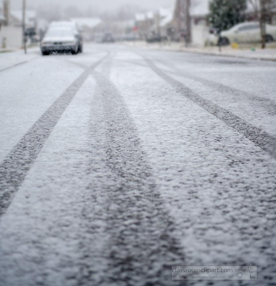 snow-covered-nieghborhood-road-with-car-tire-tracks.jpg