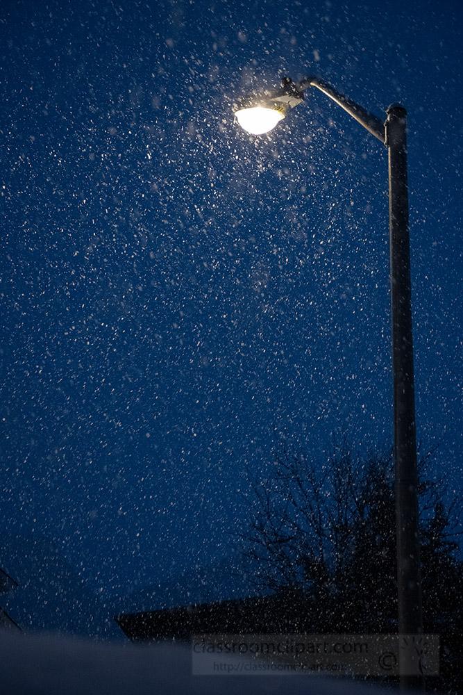 street-light-illuminates-falling-snow-flakes.jpg