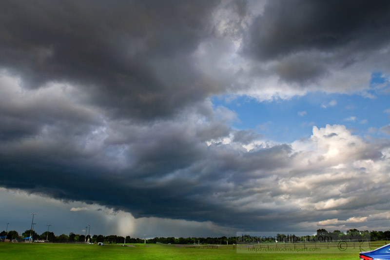 summer-storm-and-thunder-clouds-showing-rain-in-the-distance-7130.jpg